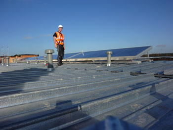 Installing solar panel in one of Scotlands domestic homes